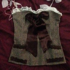 DONATED DONATED Cute Brown Corset SO CUTE! I can't get over it! White lace top trimming, super soft ribbon bow, and the pockets are functional! There's a zipper on the back. It's actually very comfortable. Says Large but I'm a Medium and it fits nicely. Quite possibly the cutest thing I own. I love this! But I don't wear it enough to justify owning it T-T I want this to go to a good home! I love to bundle! HEART MOON STAR Tops