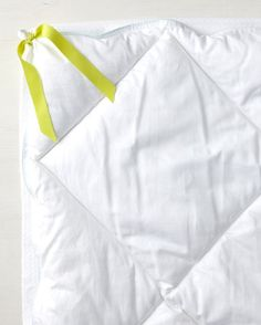 Although a duvet cover does an admirable job of protecting a comforter from stains, it is notorious for being a shifty character. Keep it and your comforter neatly in place by turning the cover inside out and sewing two pieces of five-inch-long fabric tape to all four corners. Then tie the fabric tape around each corner of the comforter, and sleep tight.