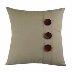 "Cotton pillow in tan with button accents. Made in Council Bluffs, Iowa.   Product: PillowConstruction Material: Cotton cover and polyester fillColor: TanFeatures:  Insert includedZipper closureMade in Council Bluffs, Iowa  Dimensions: 17"" x 17"" Cleaning and Care: Spot clean or hand wash"