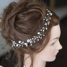 Bridal hair vine Wedding headpiece Pearl hair vine Crystal long hair vine Bridal hair accessories Crystal hair vine Freshwater pearls A beautiful bridal long hair vine. • Made of freshwater pearls, white clear glass beads, crystals, wire. • Color- ivory freshwater pearls, crystal, white