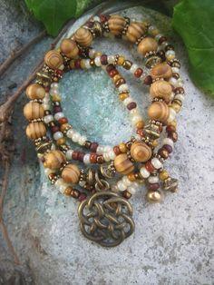 Gypsy Bohemian Mocha Stack Bracelets with Celtic Charm. $22.00, via Etsy.