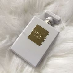 Chanel White Perfume Bottle Power Bank Charger Brand new in box. Has a little scratch on the gold part. Came like this from the manufacturer. Never been used. Can be used with any device, just use your own USB cord CHANEL Accessories Phone Cases