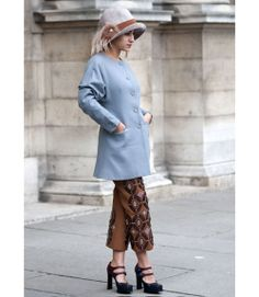 Intriguing Hat!  Paris Fashion Week Street Style Spring 2013 - Spring Fashion Week Street Style - Marie Claire