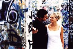 bride and groom with graffiti wedding photography