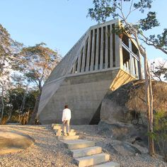 This boulder-shaped building in Acapulco, Mexico, is a mausoleum by Mexcian studio Bunker Arquitectura.