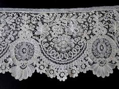 Brussels Lace Small fragment of fine machine net with appliqués of 19th century Brussels bobbin lace. Motifs all are well formed and in excellent condition Needlework filling stitches suggest it is Brussels, not English.