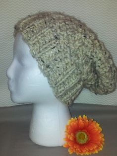 style: slouchy color: tan with black & white speckles size:adult