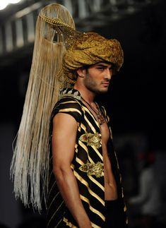 Models present creations by Pakistani designer Elemnet Jeans on the first day of Men's Fashion Week in Karachi. (AFP)A model presents a creation by Pakistani designer Shahnameh on the first day of Men's Fashion Week in Karachi. (AFP)A model presents a cre Middle Eastern Men, Middle Eastern Fashion, Mens Fashion Week, Latest Mens Fashion, Fashion Show Themes, Armor Clothing, Smart Men, Pakistan Fashion, Couture Fashion