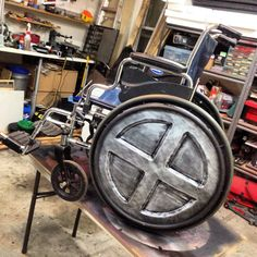 Professor X wheelchair with new wheels. This chair was on loan for the Fiesta Bowl Parade so I have to make the Xmen wheels removable. Made for EVA foam and painted.