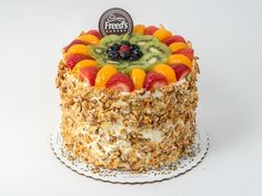 Four Seasons Cake   Delicate white cake filled with bavarian cream and fresh sliced strawberries and bananas. Iced in Freed's signature true European buttercream, topped with assorted fruit (may vary slightly from as shown), and coated around the sides with sugared almonds.