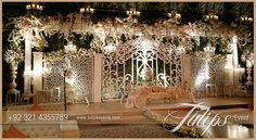 Discover most amazing Fairy wedding gate stage theme decoration arrangements by Tulips Events in Pakistan. Fairy tale carved floral backdrop with lights. Wedding Stage Decorations, Wedding Stage Design, Wedding Reception Backdrop, Marriage Decoration, Wedding Mandap, Backdrop Decorations, Backdrops, Wedding Ceremony, Pakistani Wedding Stage