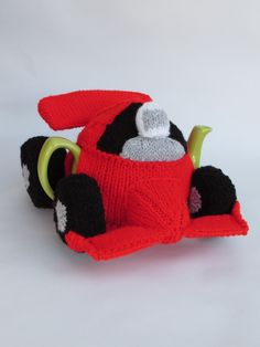 Feel like a Formula One champion every teatime with the Formula One Racing Car tea cosy http://www.teacosyfolk.co.uk/Formula-One-Racing-Car-Tea-cosy-p-165.php Pattern now available as a digital download at TeaCosyFolk