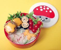 A decidedly pretty take on bento lunch featuring lovely cheese and meat butterflies. #butterflies #mushroom #Japanese #bento #food #cute #kawaii #cooking #rice #vegetables #Asian #lunch #box #meals