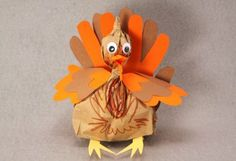 Paper Bag Turkeys | Sophie's World- I made these last week. Used red, orange, yellow, brown for handprints. No feet or side feathers. Super cute! Love the step by step directions.