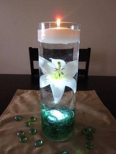 Teal centre piece with candle and marbles