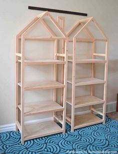 Get organized with these adorable house frame bookshelves. Free and easy plans to build a DIY house frame bookshelf. Get organized with these adorable house frame bookshelves. Free and easy plans to build a DIY house frame bookshelf. Retro Furniture, Furniture Plans, Kids Furniture, Furniture Cleaning, Furniture Movers, Furniture Stores, Luxury Furniture, Furniture Design, Bookcase Plans