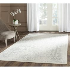 Charlton Home® Reynolds Ivory/Silver Area Rug