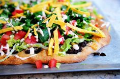Ree Drummond taco pizza: I added ground beef and made it deep dish in our cast iron skillet. Divine!