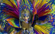 A member of Portela samba school performs during the first night of Carnival parades at the Sambadrome in Rio de Janeiro