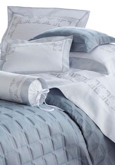 Marquetry -  Geometric clarity is foremost in this handsome, hand embroidered appliqué design. Shown here in silver-gray Swiss cotton sateen on crisp white Egyptian cotton sheeting. Available in 50 appliqué colors. Coverlet design: Athens.