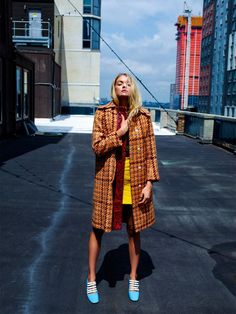 Lindsay models Miu Miu jacket, top, skirt and shoes