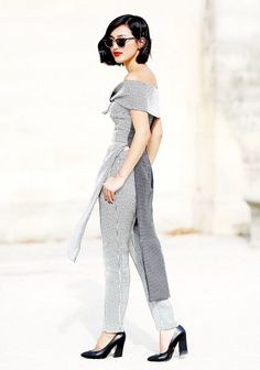 Nicole Warne of Gary Pepper struts in an off-the-shoulder tailored checked suit.
