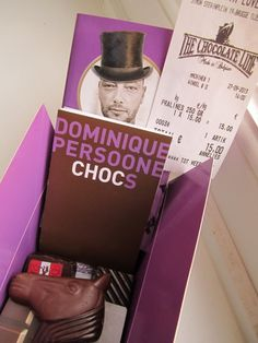 "Color photo of a box of chocolates ""The Chocolate Line"" with a credit card slip showing 15 euros."