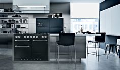 The monochrome style of this kitchen provides the ideal setting for Mercurys 1200 range cooker. The stainless steel side trims and hi-fi style knobs give a slicing edge to the Ash Black cooker.