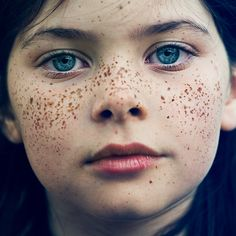 Little girl with beautiful clear blue eyes, freckles