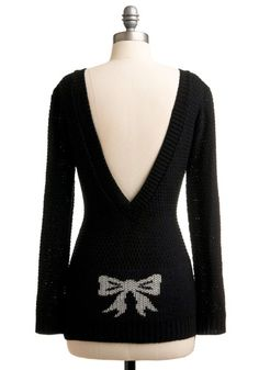 I love the deep V and the bow detail! It would look so cute over a cream lace cami.
