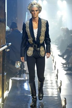 John Galliano Mens Fall/Winter 2011-2012: A modern version of the waistcoat and also the decorative elements help it look like it is inspired by the 18th century.