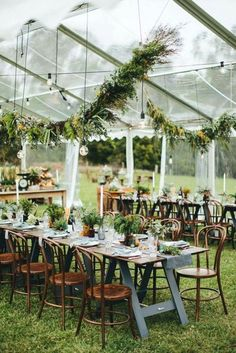 30 Wedding Tent Ideas For A Stunning Reception ❤ wedding tent reception under a transparent awning with dark wooden furniture under the ceiling and on the tables greens thisislovnd via instagram ❤ See more: http://www.weddingforward.com/wedding-tent/ #wedding #bride