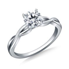 This stunning engagement ring is everything she wished for and so much more. It boasts a gorgeous design with a dazzling round .75 ct. t.w. diamond solitaire that will delight and excite. The curved infinity-styled shank adds a timeless yet unique touch that enhances the ring's overall beauty and
