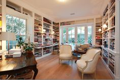 Lots of bookshelves in this library in a Texas home. Someone loves to read.