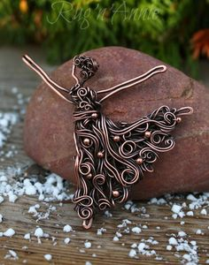 A sweet little dancer . She is aprox 3: high and hand formed out of solid copper wire. Small copper beads adorn her dress.
