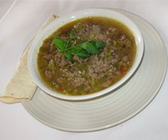 AUTHENTIC New Mexico Green Chili Stew:    8 New Mexico green Chilis(roasted and peeled)  1/2 Onion (diced)  1t. Garlic powder  1lb. Ground Beef or round steak cut in very small pieces  1 Potato (peeled and diced)  4 cups Water (approx.)  1 diced Tomato  Salt and Pepper to taste