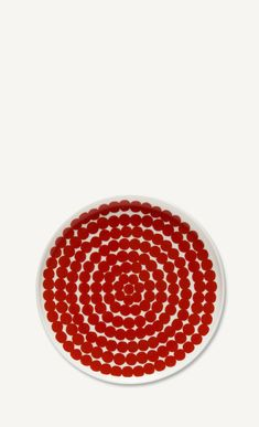 The bright red Räsymatto pattern covers this white stoneware plate. glazed color and pattern remain vibrant. Marimekko, New Print, Stoneware, Your Favorite, Finding Yourself, Artsy, Vibrant, Plates, Tableware