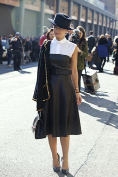 Strapless dress over sleeveless collared blouse... AND a great hat.