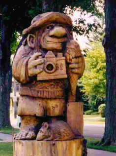 Mt. Horeb, a small town in southwestern Wisconsin, has a number of whimsical troll sculptures placed along its main street. Each sculpture was carved from a tree trunk. This particular troll is known as The Tourist. Mt. Horeb, WI. (Richard S. Buse photo)