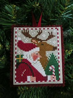 Cross Stitch Finishing a cross stitch ornament - I personally don't think the Just Cross Stitch ornie magazine is very clear with their finishing instructions for 'newbies' so I thought I'd make one up myself to help peopl… Santa Cross Stitch, Just Cross Stitch, Cross Stitch Finishing, Cross Stitch Charts, Cross Stitch Designs, Cross Stitch Patterns, Cross Stitch Christmas Ornaments, Christmas Embroidery, Noel Christmas