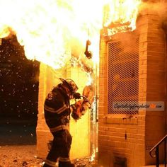 Here is a firefighter going into a fire.