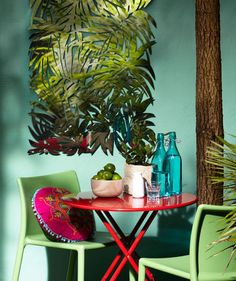 Island Style    Even a corner can explode with seasonal appeal. Set up a red bistro table, surround it with green plastic chairs, and hang a graphic piece of art on the wall.