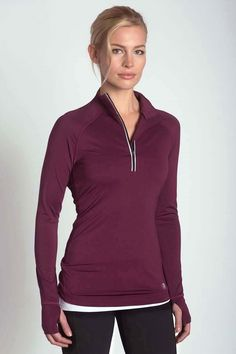 Tracker Zip Pullover This lightweight pullover makes outdoor running a breeze providing an extra layer of protection.