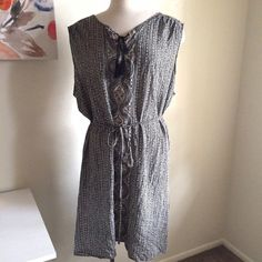 Tunic dress Great for summer! It's a black and white patterned tunic dress. It ties at the neckline. There's also a tie around the waist for a flattering shape. Lightweight and flowy. 100% rayon. Worn once. Ava & Viv Dresses