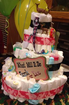 Our beautifully fun shower diaper cake made by my sister-in-law! It was also a 'guess how many diapers it took to make' game! She incorporated our Buck or Doe theme & even my love for the MN Twins:)