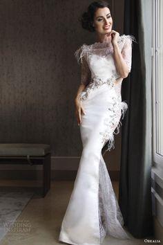 http://www.weddinginspirasi.com/2014/08/18/orkalia-couture-fall-2014-collection/ Orkalia #couture fall 2014 #wedding dress illusion neckline sleeves feathers #weddingGown #weddingDress