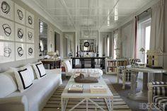 The living room of interior designer Luis Bustamante's Madrid apartment in a 1910 building.