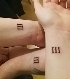Roman Numeral Sibling Tattoos on Wrist