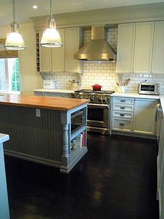 Chris Kauffman's kitchen range subway tile - note the nook for microwave & books love this kitchen!