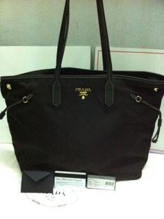 2269e4221551 12 Best Sell Prada Handbags Online images